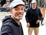 """Will Smith pictured on the set of his new movie """"Collateral Beauty"""" in New York City. Will looked very happy he was all smiles and gave a peace sign to a photographer and then he stopped and signed some autographs for some fans before getting in his car.\n\nPictured: Will Smith\nRef: SPL1242433  080316  \nPicture by: Splash News\n\nSplash News and Pictures\nLos Angeles: 310-821-2666\nNew York: 212-619-2666\nLondon: 870-934-2666\nphotodesk@splashnews.com\n"""
