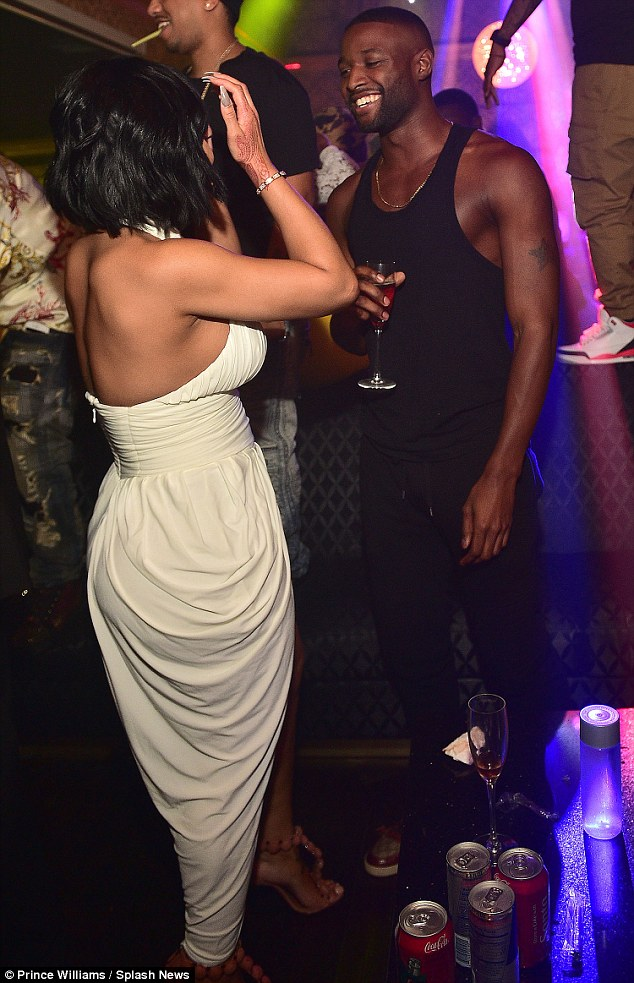 Getting on great: The pair were seen laughing and dancing together as they sipped on drinks at Medusa night club