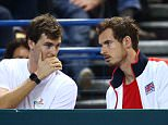 BIRMINGHAM, ENGLAND - MARCH 04:  Brothers and teammates Jamie Murray and Andy Murray of Great Britain exchange words during the singles match between Daniel Evans of Great Britain and Kei Nishikori of Japan on day one of the Davis Cup World Group first round tie at the Barclaycard Arena on March 4, 2016 in Birmingham, England.  (Photo by Jordan Mansfield/Getty Images for LTA)