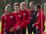 Manchester United's Dutch manager Louis van Gaal (2nd R) takes a team training session at their Carrington training complex in Manchester, north west England on September 29, 2015, ahead of their UEFA Champions League, Group B football match against VfL Wolfsburg. AFP PHOTO / OLI SCARFF        (Photo credit should read OLI SCARFF/AFP/Getty Images)