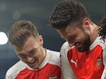 Arsenal's French striker Olivier Giroud (C) celebrates with Arsenal's English defender Calum Chambers (L) and Arsenal's Egyptian midfielder Mohamed Elneny after scoring the opening goal of the English FA cup fifth round replay football match between Hull City and Arsenal at the KC Stadium in Kingston upon Hull in north east England on March 8, 2016.  / AFP / Paul ELLIS / RESTRICTED TO EDITORIAL USE. No use with unauthorized audio, video, data, fixture lists, club/league logos or 'live' services. Online in-match use limited to 75 images, no video emulation. No use in betting, games or single club/league/player publications.  / PAUL ELLIS/AFP/Getty Images