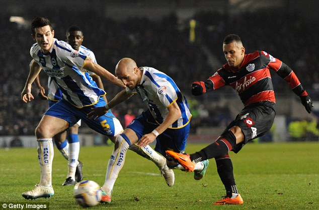 The 21-year-old (right) takes a shot during a match for Queens Park Rangers against Brighton in March