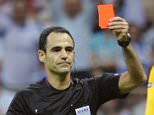 Referee Carlos Velasco Carballo of Spain (L) shows a red card to Poland's goalkeeper Wojciech Szczesny during their Group A Euro 2012 soccer match against Greece at the National stadium in Warsaw, Poland.   REUTERS/Pawel Ulatowski (POLAND  - Tags: SPORT SOCCER)