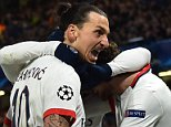 Paris Saint-Germain's Swedish forward Zlatan Ibrahimovic (C) celebrates scoring his team's second goal during the UEFA Champions League round of 16 second leg football match between Chelsea and Paris Saint-Germain (PSG) at Stamford Bridge in London on March 9, 2016.  / AFP / BEN STANSALLBEN STANSALL/AFP/Getty Images