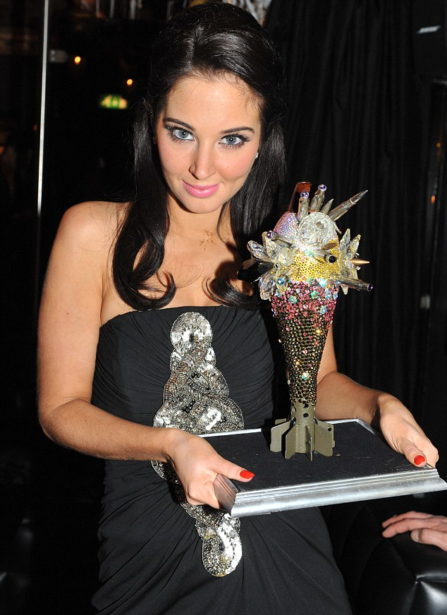 Bringing a smile to her face: Tulisa was given a diamond-encrusted trophy reportedly worth £45,000