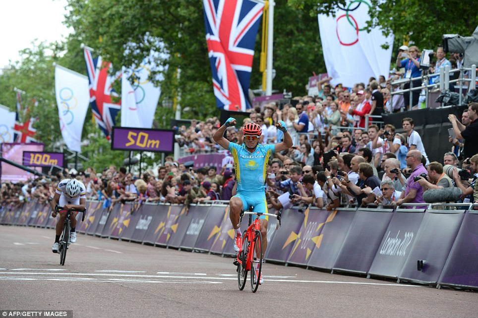 Fight to the finish: Kazakhstan's Alexandre Vinokourov dashed Britain's hopes of an early gold medal by powering to victory over favourite Mark Cavendish