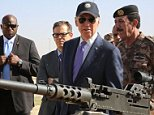 CORRECTION - US vice president Joe Biden (C) attends a military demonstration at a Joint Training Center outside the city of Zarqa, northeast of the capital Amman, on March 10, 2016. Biden met with King Abdullah during a visit to Jordan, a key ally in the fight against the Islamic State jihadist group, on the latest leg of a Middle East tour. / AFP PHOTO / KHALIL MAZRAAWI / The erroneous mention[s] appearing in the metadata of this photo by KHALIL MAZRAAWI has been modified in AFP systems in the following manner: [in the city of Zarqa] instead of [outside the city of Zarqa]. Please immediately remove the erroneous mention[s] from all your online services and delete it (them) from your servers. If you have been authorized by AFP to distribute it (them) to third parties, please ensure that the same actions are carried out by them. Failure to promptly comply with these instructions will entail liability on your part for any continued or post notification usage. Therefore we thank you ver