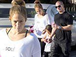 """EXCLUSIVE: Jennifer Lopez takes her daughter Emme and boyfriend Casper Smart out for frozen yoghurt.  The trio were spotted in Calabasas on Wednesday afternoon.  J Lo wore a white scoop neck sweater with the slogan """"Love your soul and be happy"""" written on it. \n\nPictured: Jennifer Lopez,Emme Lopez,Casper Smart\nRef: SPL1243752  090316   EXCLUSIVE\nPicture by: Splash News\n\nSplash News and Pictures\nLos Angeles: 310-821-2666\nNew York: 212-619-2666\nLondon: 870-934-2666\nphotodesk@splashnews.com\n"""
