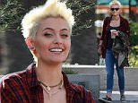 149228, EXCLUSIVE: Paris Jackson sports her new punker bleach blonde hair as she illegally smokes and hangs out with friends in Malibu. The 17 year old daughter of Michael Jackson drastically changed her look by chopping off her long dark locks, dying it first a strawberry blonde before the bleach blonde. Photograph: © PacificCoastNews. Los Angeles Office: +1 310.822.0419 sales@pacificcoastnews.com FEE MUST BE AGREED PRIOR TO USAGE