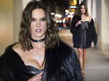 PARIS, FRANCE - MARCH 08:  Alessandra Ambrosio is wearing a Valentino dress, Saint Laurent coat, Gianvito Rossi shoes, Shay jewelry seen in the streets of Paris on March 8, 2016 in Paris, France.  (Photo by Timur Emek/GC Images)