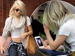 Beverly Hills, CA - Julianne Hough visits Beverly Hills Nail Design with her friends. The 27-year-old actress FaceTimes her fiance, NHL hockey player Brooks Laich. The two got engaged in August of 2015, and Julianne announced the engagement on Instagram. Julianne is wearing jeans and a white crop top paired with a plaid shirt tied around he waist and platform heels.\n  \nAKM-GSI        March 8, 2016\nTo License These Photos, Please Contact :\nSteve Ginsburg\n(310) 505-8447\n(323) 423-9397\nsteve@akmgsi.com\nsales@akmgsi.com\nor\nMaria Buda\n(917) 242-1505\nmbuda@akmgsi.com\nginsburgspalyinc@gmail.com