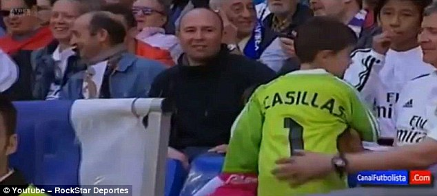 The young fan looked delighted to have been handed Casillas' No 1 shirt during the interval