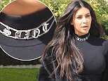 """Kim Kardashian flaunts her incredible post-baby curves, and wears a """"Saint"""" monogrammed choker as she steps out for lunch with sister Kourtney Kardashian at Hugo's in Calabasas, CA. Kourtney dons a Cougar Lounge t-shirt. Wednesday, March 9, 2016. AZ/X17online.com"""