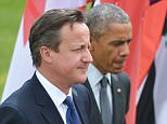 Britain's Prime Minister David Cameron (L) and US President Barack Obama arrive for the G7 leaders and outreach partners family during the G7 Summit at the Schloss Elmau castle resort near Garmisch-Partenkirchen, in southern Germany on June 8, 2015.    AFP PHOTO / MANDEL NGANMANDEL NGAN/AFP/Getty Images