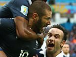 Karim Benzema of France celebrates scoring the first goal with Patrice Evra, Mathieu Valbuena and Antoine Griezmann during the 2014 FIFA World Cup Brazil Group E match between France and Honduras (3-0) at Estadio Beira-Rio on June 15, 2014 in Porto Alegre, Brazil.  (Photo by Ian Walton/Getty Images)