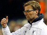 Liverpool manager Juergen Klopp gestures during the Europa League round of 16, first leg, soccer match between Liverpool and  Manchester United at Anfield Stadium, Liverpool, England, Thursday March 10, 2016. Liverpool won 2-0. (AP Photo/Jon Super)