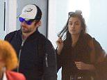 Bradley Cooper and Irina Shayk arrive at JFK airport in NYC.  Pictured: Bradley Cooper and Irina Shayk Ref: SPL1244522  100316   Picture by: Splash News  Splash News and Pictures Los Angeles: 310-821-2666 New York: 212-619-2666 London: 870-934-2666 photodesk@splashnews.com