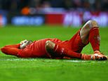 Emre Can of Liverpool feels the pain from a knock after an off the ball challenge with Marouane Fellaini during the UEFA Europa League Round of 16 First Leg match between Liverpool and Manchester United played at Anfield Stadium, Liverpool on March 10th 2016