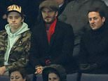 Football Soccer - Chelsea v Paris St Germain - UEFA Champions League Round of 16 Second Leg - Stamford Bridge, London, England - 9/3/16  David Beckham with his son Brooklyn and Dave Gardner in the stands  Action Images via Reuters / John Sibley  Livepic  EDITORIAL USE ONLY.