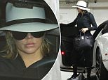 Khloe Kardashain dons a cute summer hat while arriving for her daily workout in Beverly Hills. Khloe's lips are looking extra plump, once again. March 11, 2016 X17online.com
