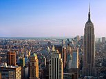 A Stock photo of the Empire State building and the skyline of Manhattan, New York City.   BXTAKR