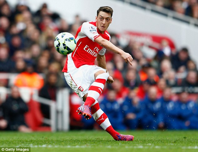 Mesut Ozil doubled Arsenal's lead at the Emirates with this perfectly-placed free-kick past Simon Mignolet