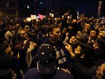 Mandatory Credit: Photo by Chris Sweda/Chicago Tribune/REX/Shutterstock (5612885n) Trump supporters and protesters clash outside the UIC Pavilion after the cancelled rally for the Republican presidential candidate in Chicago Donald Trump presidential campaigning, Chicago, America - 11 Mar 2016