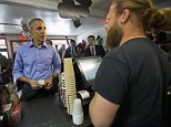 President Barack Obama places his taco order with Torchyís Tacos owner Aaron Sego, right, during an unannounced stop at Torchyís Tacos, Friday, March 11, 2016, in Austin, Texas. Obama traveled to Austin, to speak at South by Southwest Festival (SXSW) and attend two Democratic National Committee fundraisers. (AP Photo/Pablo Martinez Monsivais)
