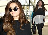 Los Angeles, CA - Selena Gomez arrived from a trip across the pond. The singer and actress made a quick appearance at Capital Radio in London and flew back home to LA. She was wearing a Alice + Olivia shirt and pants, a Barrie Glamour sweater, Soebedar shoes, and a little bucket bag by Louis Vuitton.\nAKM-GSI        March 11, 2016\nTo License These Photos, Please Contact :\nSteve Ginsburg\n(310) 505-8447\n(323) 423-9397\nsteve@akmgsi.com\nsales@akmgsi.com\nor\nMaria Buda\n(917) 242-1505\nmbuda@akmgsi.com\nginsburgspalyinc@gmail.com