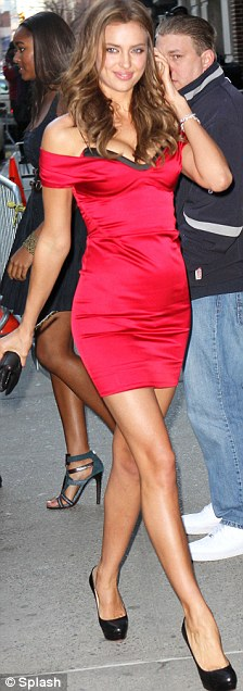 Lady in red: Irina wore a little red dress while holding a matching rose for her appearance on The Late Show with David Letterman in NYC on Monday night