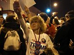 Donald Trump supporter Birgitt Peterson of Yorkville, Ill., argues with protesters outside the UIC Pavilion after the cancelled rally for the Republican presidential candidate in Chicago on Friday, March 11, 2016. (E. Jason Wambsgans/Chicago Tribune/TNS)