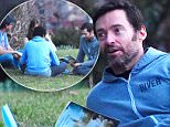 *EXCLUSIVE* New York, NY - Hugh Jackman reads 'A Separate Peace' with his son and friends at Hudson River Park. 'A Separate Peace' is a coming of age novel that explores morality, patriotism and loss of innocence through its narrator, Gene. Jackman keeps it casual in jeans and a hoodie as he spends time with his loved ones. \n  \nAKM-GSI       March 10, 2016\nTo License These Photos, Please Contact :\nSteve Ginsburg\n(310) 505-8447\n(323) 423-9397\nsteve@akmgsi.com\nsales@akmgsi.com\nor\nMaria Buda\n(917) 242-1505\nmbuda@akmgsi.com\nginsburgspalyinc@gmail.com