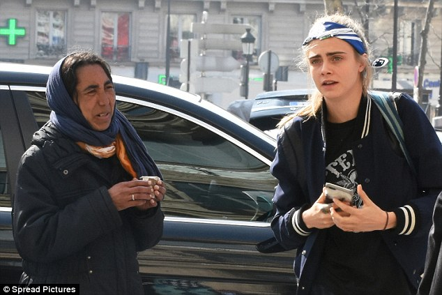 Not now... Cara Delevingne appeared to be void of loose change after she was spied dodging a beggar outside Gare du Nord railway station in Paris on Saturday afternoon