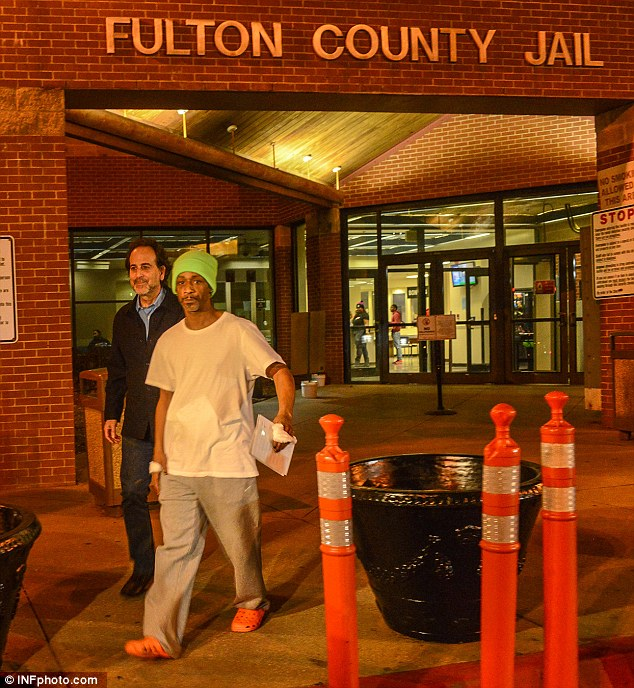 Uniform:He seemed to be wearing what appeared to be standard issue jail garb, including a grey t-shirt, grey sweatpants and neon orange crock-style rubber sandals