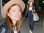 149330, EXCLUSIVE: Olivia Wilde seen arriving at John F. Kennedy International Airport in New York City. Olivia arrives from Los Angeles this evening she seen signing autograph and taking selfie with fans while heading towards her car. New York, New York - Friday March 11, 2016. Photograph: © PacificCoastNews. Los Angeles Office: +1 310.822.0419 sales@pacificcoastnews.com FEE MUST BE AGREED PRIOR TO USAGE