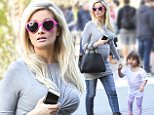 Exclusive... 51995090 Pregnant 'Sharknado 3' actress Holly Madison was spotted shopping with her family at the Grove in Hollywood, California on March 12, 2016.  Holly recently opened up about how Hugh Hefner would request that all the Playboy girls looked similar, encouraging them to get plastic surgery. FameFlynet, Inc - Beverly Hills, CA, USA - +1 (310) 505-9876