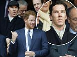 Britain's Prince Harry, center, stands with president of the English Rugby Football Union Jason Leonard, right, as British actor Benedict Cumberbatch stands at left with flat cap on in the row behind, before the Six Nations international rugby match between England and Wales at Twickenham stadium in London, Saturday, March,12, 2016. (AP Photo/Alastair Grant)