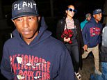 Los Angeles, CA - Singer, Pharrell Williams, arrives at LAX holding hands with his wife, Helen Lasichanh.  He was seen wearing a pullover hoodie with 'Billionaire Boys Club' on it, khaki pants, and gray suede boots.  How wife, Helen Laichanh, was seen in a black sweater, striped shirt, black overalls, black socks, Birkenstock sandals, and blue frame sunglasses.\nAKM-GSI          March 1, 2016\nTo License These Photos, Please Contact :\nSteve Ginsburg\n(310) 505-8447\n(323) 423-9397\nsteve@akmgsi.com\nsales@akmgsi.com\nor\nMaria Buda\n(917) 242-1505\nmbuda@akmgsi.com\nginsburgspalyinc@gmail.com