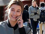 EXCLUSIVE TO INF.\nMarch 11, 2016: Hailey Baldwin in good spirits as she talks on her phone, outside Bar Pitti in New York City this afternoon.\nMandatory Credit: INFphoto.com\nRef: infusny-279