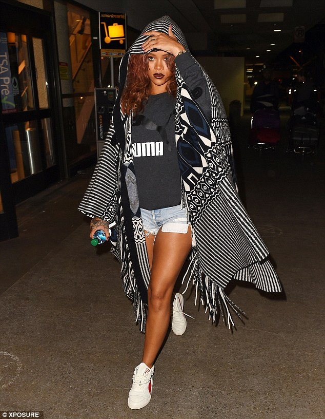 A leggy display: Rihanna caught the eye in a pair of cut-off denim shorts as she made her way across LAX International airport in Los Angeles on Tuesday evening