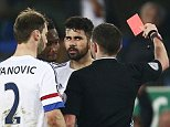 Referee Mr Michael Oliver shows Diego Costa of Chelsea a red card during the Emirates FA Cup Quarter Final match between Everton and Chelsea played at Goodison Park, Liverpool on March 12th 2016
