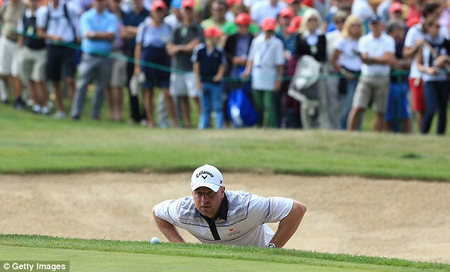 Flag daze: Lee lines up a putt on the 15th green