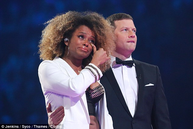 Emotional stuff: Fleur fights back the tears as she watches her best moments with Dermot