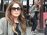 12.3.16...... Binky Felstead from Made in Chelsea is spotted walking through Manchester city centre on Saturday afternoon after doing a photo shoot at Artisan Reastaurant. When she spotted that she was being photographed she stopped to put huge sunglasses on.