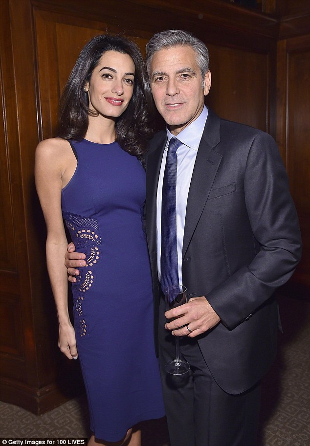Power couple: Amal is married to actor George Clooney, right