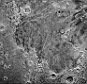 Far in the western hemisphere, scientists on NASA?s New Horizons mission have discovered what looks like a giant ?bite mark? on Pluto?s surface. They suspect it may be caused by a process known as sublimation?the transition of a substance from a solid to a gas. The methane ice-rich surface on Pluto may be sublimating away into the atmosphere, exposing a layer of water-ice underneath.      In this image, north is up. The southern portion of the left inset above shows the cratered plateau uplands informally named Vega Terra (note that all feature names are informal). A jagged scarp, or wall of cliffs, known as Piri Rupes borders the young, nearly crater-free plains of Piri Planitia. The cliffs break up into isolated mesas in several places.  Cutting diagonally across the mottled plans is the long extensional fault of Inanna Fossa, which stretches eastward 370 miles (600 kilometers) from here to the western edge of the great nitrogen ice plains of Sputnik Planum.  Compositional data from