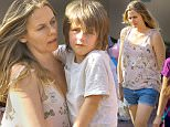 EXCLUSIVE: Alicia Silverstone carried her son Bear on her back on a trip to Disneyland. Alicia Silverstone wore cutoff denim shorts, a tan blouse and sneakers during the outing.\n\nPictured: Alicia Silverstone, Bear Blu Jarecki\nRef: SPL1241493  130316   EXCLUSIVE\nPicture by: Boggs / Splash News\n\nSplash News and Pictures\nLos Angeles: 310-821-2666\nNew York: 212-619-2666\nLondon: 870-934-2666\nphotodesk@splashnews.com\n