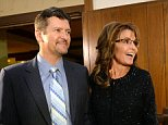 Sarah Palin, right, former Governor of Alaska, and her husband, Todd, arrive at the Grove Park Inn for a celebration of Billy Graham's 95th birthday in Asheville, N.C., on Thursday, Nov. 7, 2013. (Todd Sumlin/Charlotte Observer/MCT)