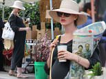 *EXCLUSIVE* Beverly Hills, CA - Anne Hathaway proves she can rock any look while pregnant. The actress was spotted earlier this week hiking with her husband in a sheer top showing off her belly and was now seen grabbing Sunday night's ingredients for dinner at the local farmer's market. She wore a sweeping, gray, long sleeve maxi dress, sunhat and sunglasses, all while holding onto multiple bags of goods. She looked relaxed and glowing as she picked up a bouquet of flowers for her table at home. \n  \nAKM-GSI        March 13, 2016\nTo License These Photos, Please Contact :\nSteve Ginsburg\n(310) 505-8447\n(323) 423-9397\nsteve@akmgsi.com\nsales@akmgsi.com\nor\nMaria Buda\n(917) 242-1505\nmbuda@akmgsi.com\nginsburgspalyinc@gmail.com