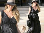 Beverly Hills, CA - A glowing Chrissy Teigen stops by Barneys New York for a shopping spree. The 30-year-old model brings her dog Pippa along for a doggy's day out. Chrissy is wearing an long black dress that hugs her baby bump on a windy LA day. She is expecting her first child later this year with husband John Legend. \n  \nAKM-GSI      March, 14, 2016\nTo License These Photos, Please Contact :\nSteve Ginsburg\n(310) 505-8447\n(323) 423-9397\nsteve@akmgsi.com\nsales@akmgsi.com\nor\nMaria Buda\n(917) 242-1505\nmbuda@akmgsi.com\nginsburgspalyinc@gmail.com